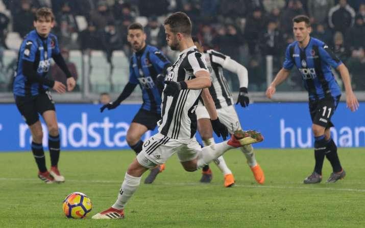 India Tv - Miralem Pjianic of Juventus scores the opener in the semis.