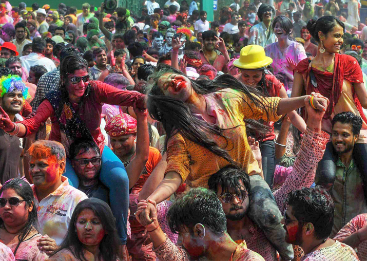 People dance during 'Rangotsav 'as they celebrate the