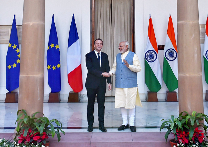 Prime Minister Narendra Modi shakes hands with French