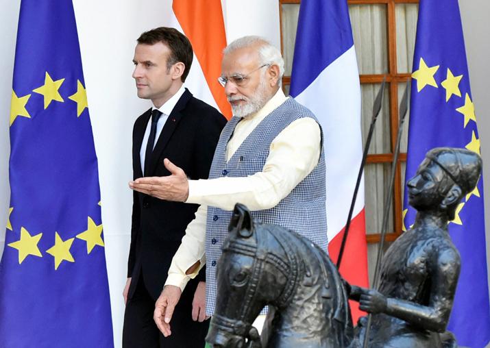 Prime Minister Narendra Modi walks with French President