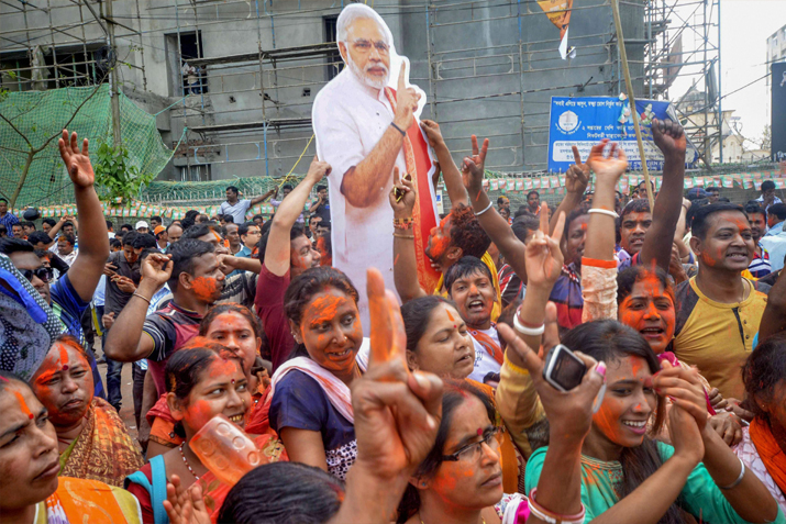 India Tv - BJP supporters hold up a placard of Prime Minister Narendra Modi after party's victory in Tripura Assembly elections results in Agartala on Saturday. BJP's win marks an end to 25 years of CPI-M government rule in the state.