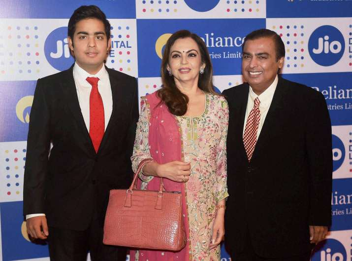 India's richest man Mukesh Ambani with his wife and son