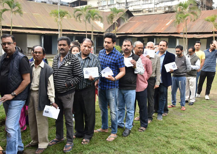 India Tv - People wait in queues to cast their vote during Nagaland Assembly elections in Dimapur on Feb 27