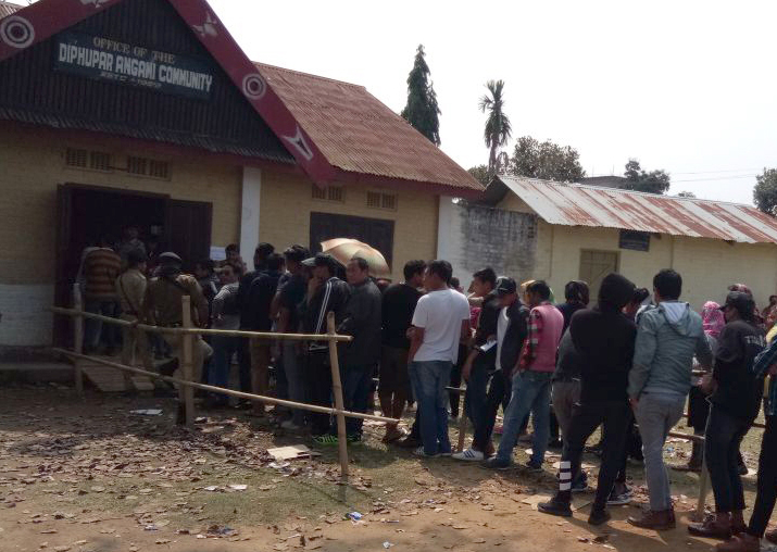 People wait in queues to cast their vote during Nagaland