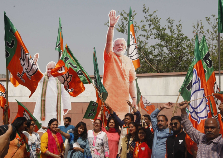 BJP workers celebrate the party's performance in the