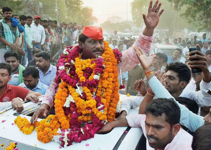 India Tv - Samajwadi Party candidate Nagendra Pratap Singh Patel celebrate after the results of Phulpur Lok Sabha bypoll election, in Allahabad on Wednesday.