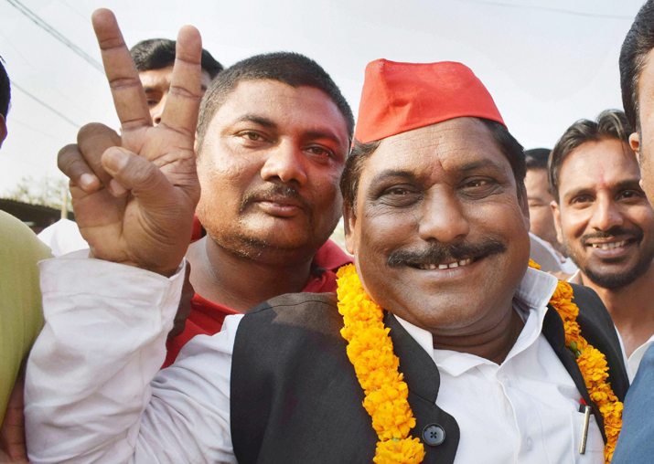 India Tv - Samajwadi Party candidate Nagendra Pratap Singh Patel shows a victory sign after the Phulpur Lok Sabha bypoll election results, in Allahabad on Wednesday.