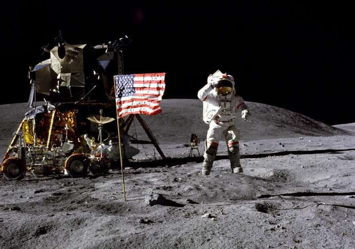 Astronaut leaping on lunar surface near landing vehicle and