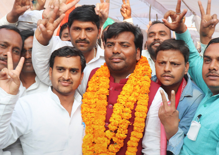 India Tv - Samajwadi Party candidate Praveen Kumar Nishad flashes victory sign after his success in the bypoll elections, in Gorakhpur on Wednesday.