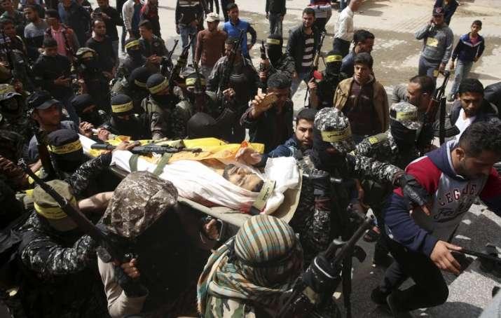Fateh masked militants carry the body of Hamdan Abu Amsha,