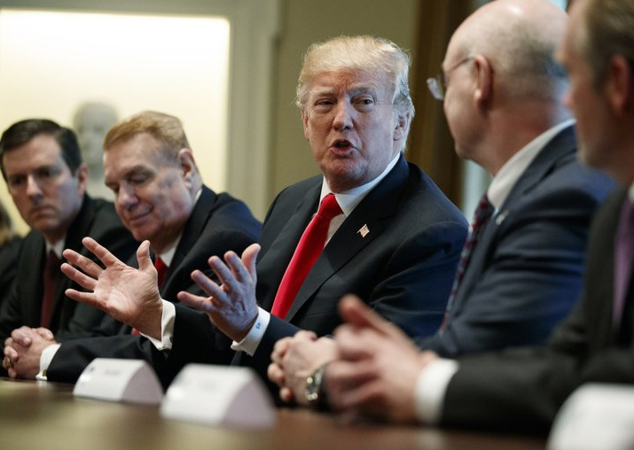President Donald Trump speaks during a meeting with steel
