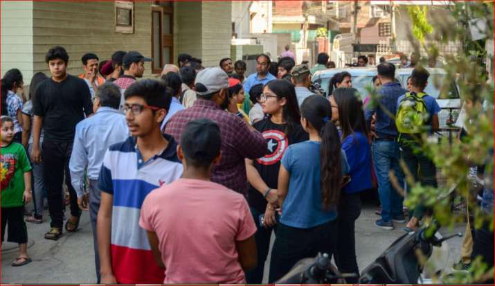 India Tv - Students and parents gather outside a coaching center in Rajendra Nagar where Delhi Police conducts an investigation for their alleged involvement in CBSE question paper leak in New Delhi on Thursday.