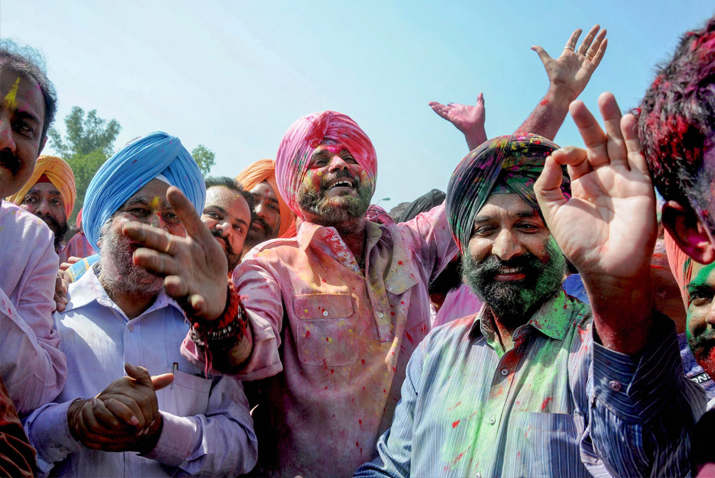 India Tv - Punjab Cabinet Minister Navjot Singh Sidhu with Border Security Force (BSF) personnel and others dance as they celebrate the festival of 'Holi 'at BSF headquarters at Khasa, some 15 kms from Amritsar on Friday.