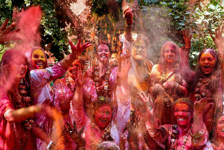 India Tv - Revelers smear colour in the air as they celebrate 'Holi' festival, in Bikaner, Rajasthan on Friday.