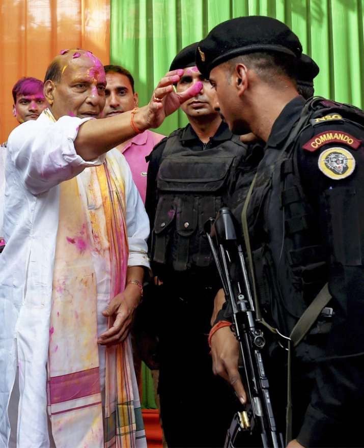 India Tv - Union Home Minister Rajnath Singh celebrates 'Holi' with NSG commandos at his residence in New Delhi on Friday.
