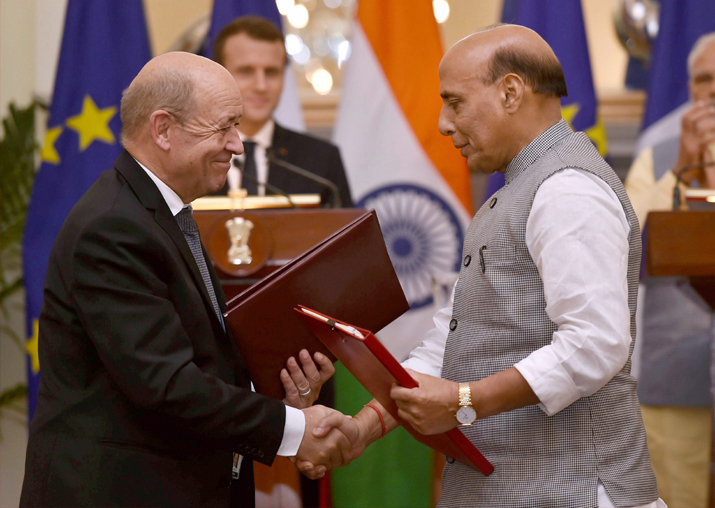 Home Minister Rajnath Singh exchanges documents with French