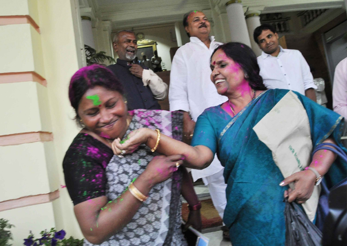 India Tv - RJD workers celebrate in Patna after the party won by-polls