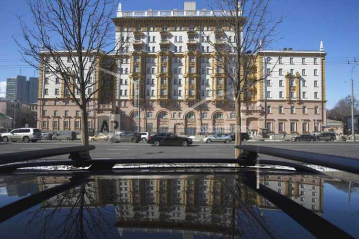 The US Embassy is reflected in a car in Moscow, Russia on