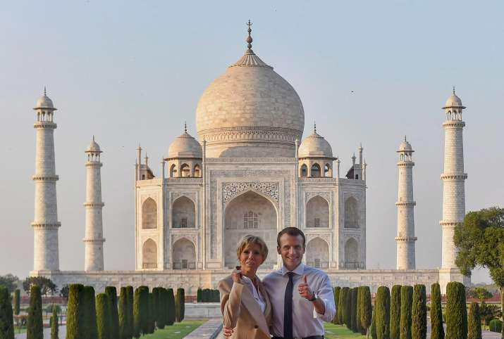 India Tv - French President Emmanuel Macron along with First Lady Brigitte Macron pose for a photograph outside Taj Mahal in Agra