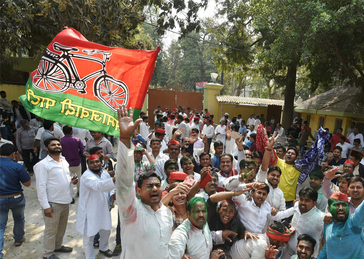 Samajwadi party workers celebrate their party success in