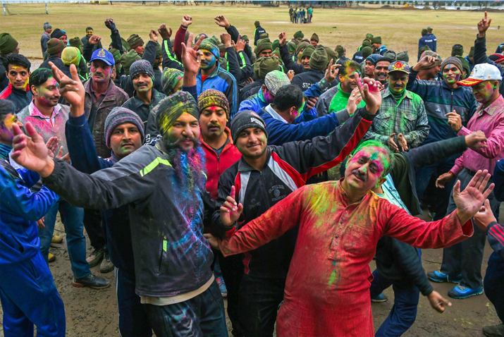 India Tv - BSF soldiers dance during 'Holi' celebrations at a camp in Humhama on the outskirts of Srinagar on Friday.