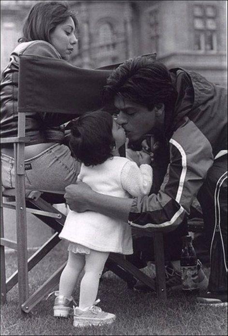 India Tv - Shah Rukh kisses son Aryan Khan while Gauri sits beside them.
