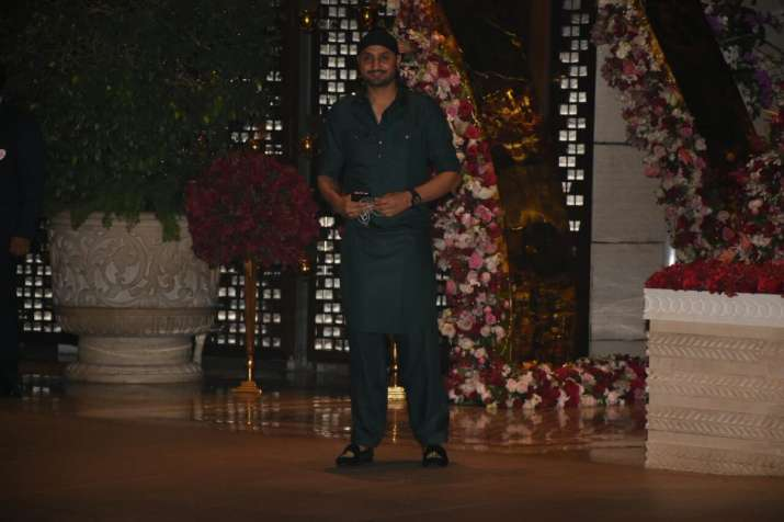 India Tv - Bhajji looked in all Punjabi mode as he attended the celebration party after Akash and Shloka swapped rings on Saturday