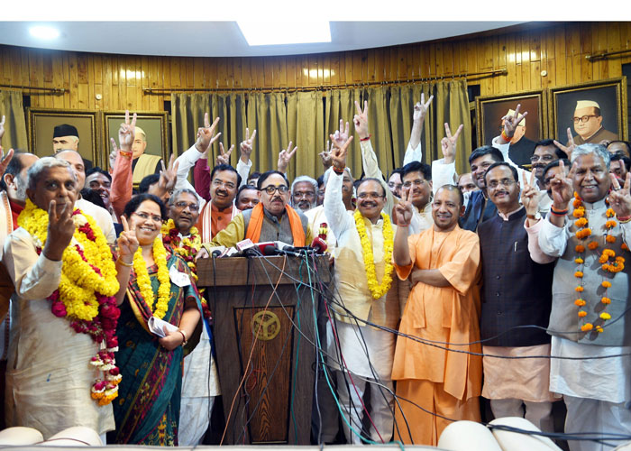 Uttar Pradesh Chief Minister Yogi Adityanath flashes the