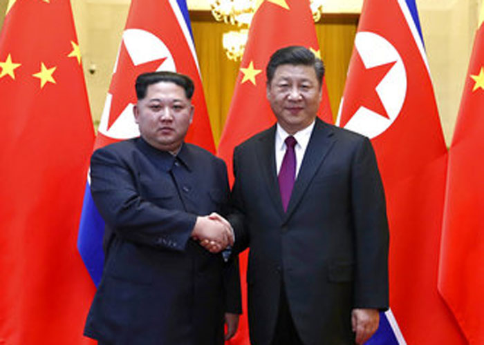 North Korean leader Kim Jong Un, left, and Chinese