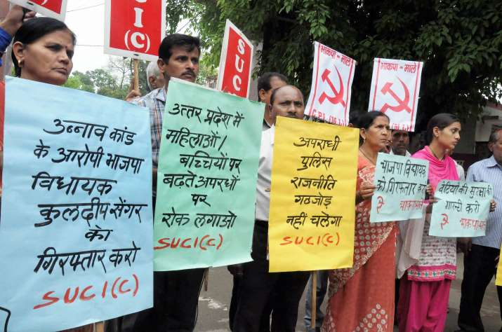 India Tv - Moradabad: Activists of SUCI (C) and CPI (ML) display placards during a protest over Unnao rape case, in Moradabad on Wednesday