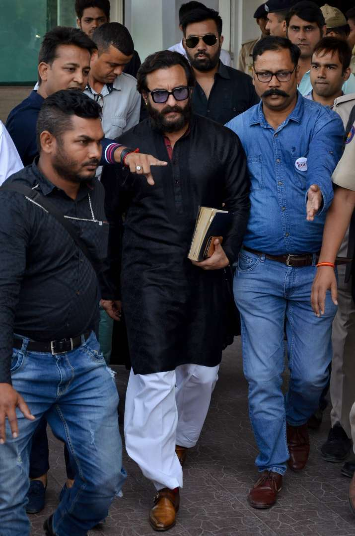 India Tv - Jodhpur: Film actor Saif Ali Khan leaves Jodhpur airport to appear in the chief judicial magistrate court in the 1998 Blackbuck hunting case, in Jodhpur on Wednesday.