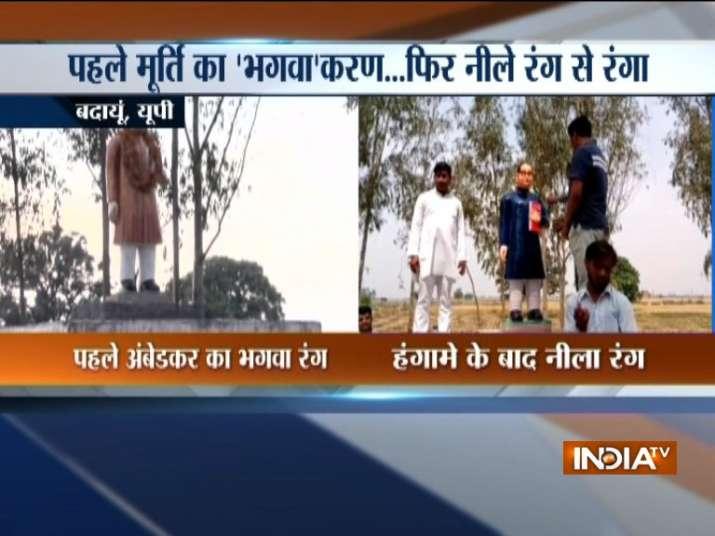 BSP leader repaints UP govt's 'saffron' Ambedkar statue blue