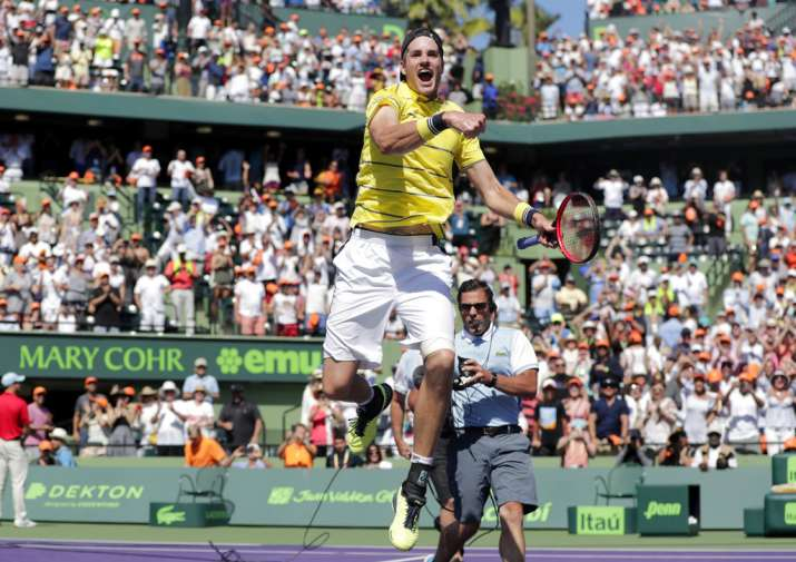 India Tv - Isner jumps with glee after winning the finals