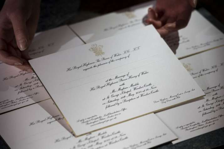 India Tv - The invitations, which are beveled and gilded along the edges, feature Prince Charles' three-feather badge embossed in gold. They feature italic writing on thick white card, and are issued under the name of Charles, father of the groom.