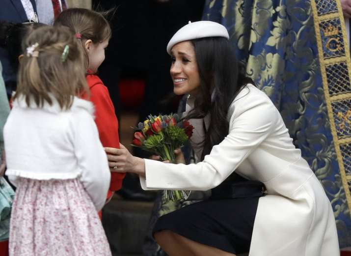 India Tv - Meghan Markle received flowers as she left after attending the Commonwealth Service at Westminster Abbey in London on March 12.