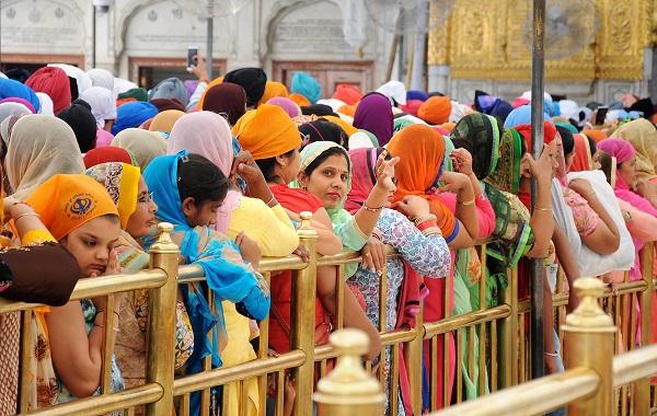 India Tv - Amritsar: Sikh devotees wait to offer prayers at Harmandir Sahib (Golden Temple) on the occasion of Baisakhi festival