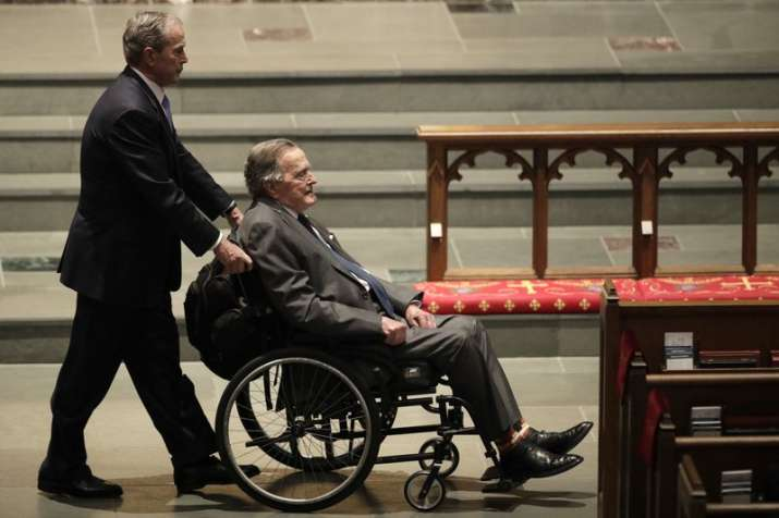 Foremer Presidents George W. Bush, left, and George H.W.