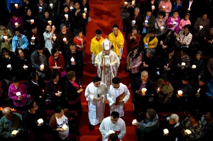 Chinese Bishop Joseph Li Shan, center, walks down the