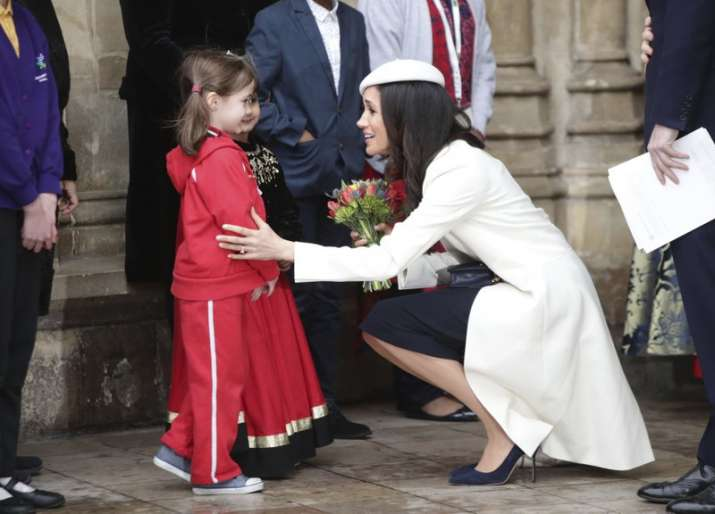 India Tv - Meghan Markle talking to children while leaving Commonwealth Service at Westminster Abbey in London on March 12