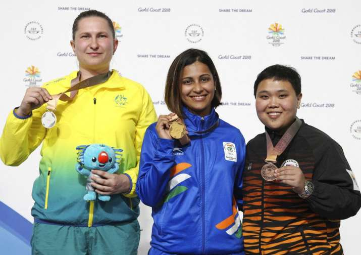 India Tv - Winner Heena Sidhu of India, center, poses with Elena Galiabovitch of Australia, left, silver, and Alia Sazana Azahari of Malaysia, bronze, on the podium during the women's 25m Pistol final