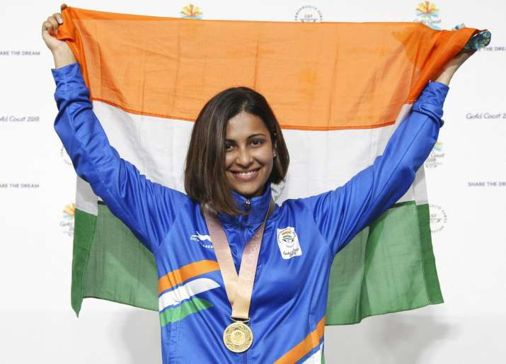 India Tv - Heena Sidhu poses with the Indian flag after winning the gold medal during the women's 25m Pistol final