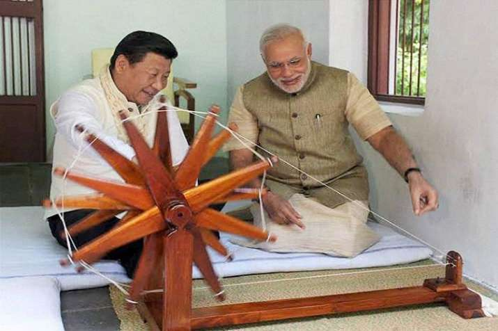 India Tv - Chinese President Xi Jinping trying his hands at Mahatma Gandhi's charkha at Sabarmati Ashram during his India visit in September, 2014.