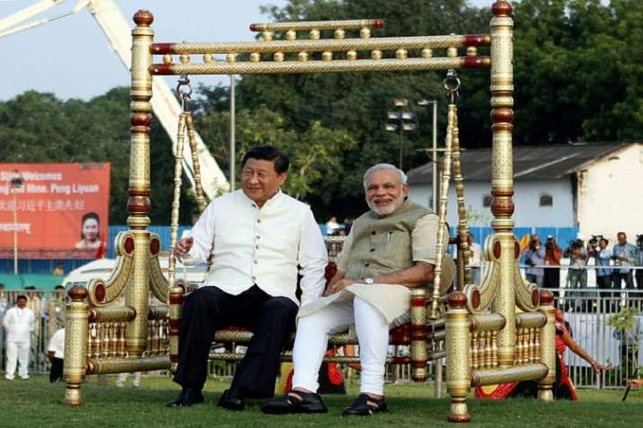 India Tv - PM Modi with Ji Xinping at the Sabarmati riverfront in Ahmedabad in September, 2014.