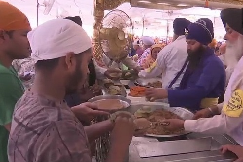 India Tv - People have 'prasad' at the Golden Temple on the occasion of Baisakhi