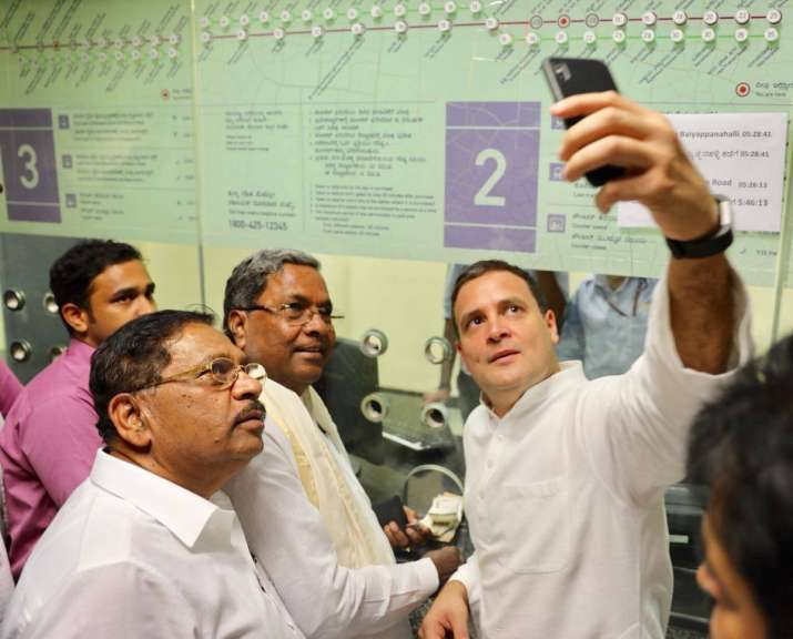 India Tv - Congress President Rahul Gandhi clicks a selfie with Karnataka Chief Minister Siddaramiah before his ride in the Namma Metro in Bengaluru