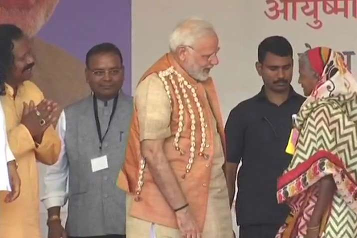 PM Modi gifted pair of slippers to a tribal woman in