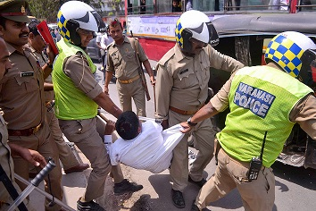 India Tv - Varanasi: Police personnel takes away an activist during 'Bharat Bandh' call by Dalit organisations against the alleged 'dilution' of Scheduled Castes/Scheduled Tribes act, in Moradabad on Monday.