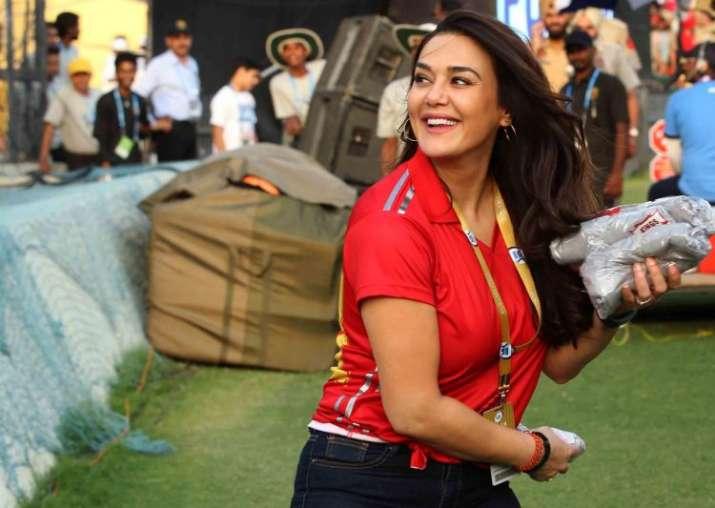 India Tv - Preity Zinta distributes KXIP jerseys among spectators during the IPL match