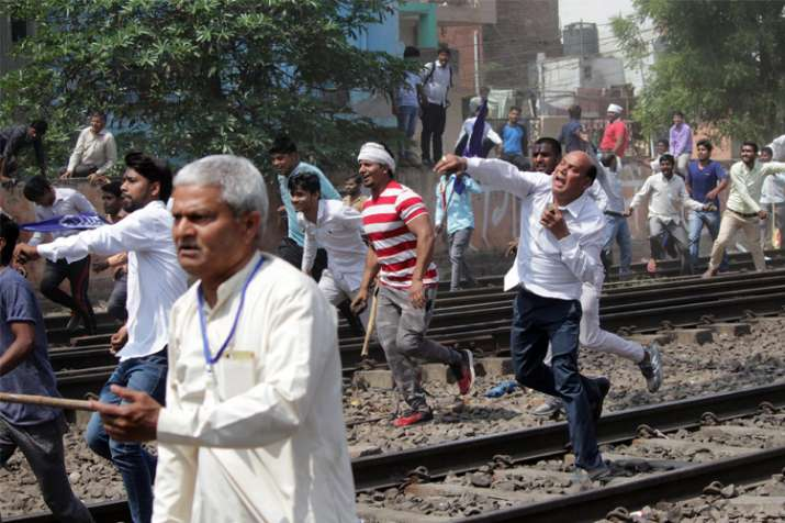 Protesters throw stones during 'Bharat Bandh' call given by