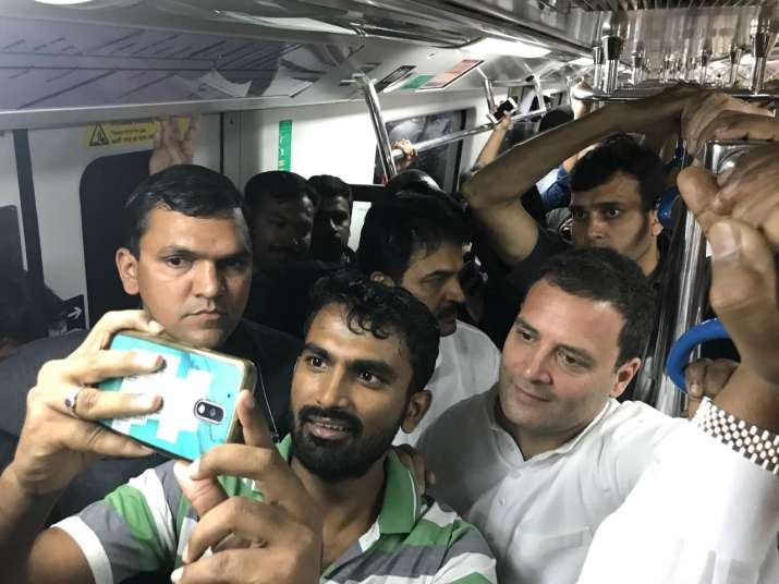 India Tv - Supporters click selfies with Rahul Gandhi as he travels from Vidhana Soudha to M G Road in Namma Metro